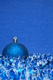 Blue shiny christmas ball Stock Images