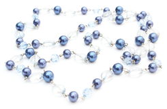Blue, shiny necklace for the woman on white background Royalty Free Stock Photography