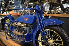 Blue motorbike in Beaulieu Motor Museum. Blue shiny old motorbike in The National Motor Museum Beaulieu royalty free stock photo