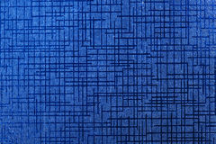 Blue shiny paper with abstract pattern close up Royalty Free Stock Images