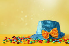 Blue shiny party Hat next to colorful candies royalty free stock photo