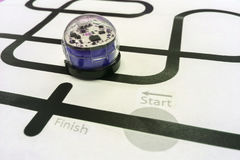 Blue Shiny Plastic Metal Robotic Car Like Programmed to Run on Black Line of White Paper. Creative Game for Kids to Practice Brain and Programming Skill at Home Royalty Free Stock Image
