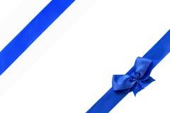 Blue shiny ribbon bow isolated on white background.  Royalty Free Stock Photo