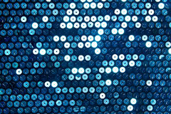 Blue shiny silver fabric with sequins Stock Images