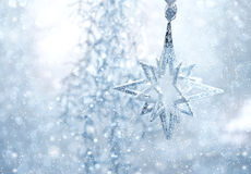 Blue shiny star. christmas or new year decoration. Abstract background with snow effect Stock Photography