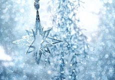 Blue shiny star. christmas or new year decoration. Abstract background with snow effect Royalty Free Stock Photo