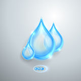 Blue shiny water drops Royalty Free Stock Images