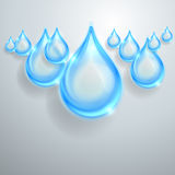 Blue shiny water drops Royalty Free Stock Image