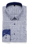 Blue shirt. Blue man's folded shirt on white Stock Photo