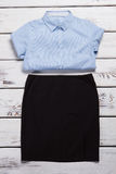 Blue shirt and black skirt. Stock Images