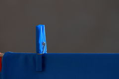 Blue shirt and blue clothespin. Blue clothespin and blue dress stock photos