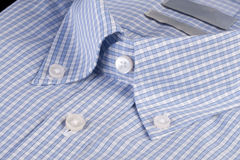 Blue shirt with button-down collar royalty free stock photos