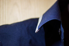 Blue shirt collar with button. Royalty Free Stock Image