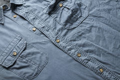 Blue shirt. Ironed and none ironed men's shirt as full frame concept background Royalty Free Stock Images