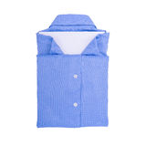 Blue shirt isolated on white background. How to fold a shirt using a white sheet Royalty Free Stock Photo