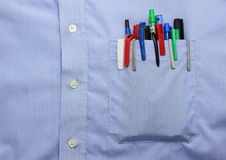 Blue shirt pocket with many different ballpoint pen and bottoms Stock Photo