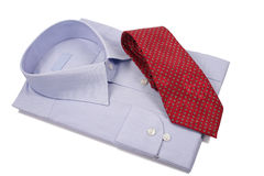Blue shirt with red tie. Isolated on white Stock Images