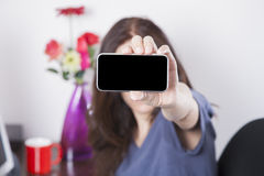 Blue shirt woman showing screen smartphone Royalty Free Stock Image