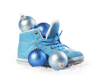 Blue shoe with Christmas decorations Stock Photos