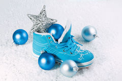 Blue shoe with Christmas decorations in the snow. Stock Image