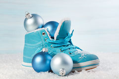 Blue shoe with Christmas decorations in the snow. Royalty Free Stock Images