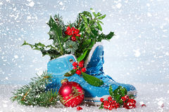 Blue shoe with Holly leaves and berries. Royalty Free Stock Photo