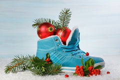 Blue shoe with Holly leaves and berries. Royalty Free Stock Photos