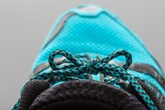Blue shoelaces on grey Stock Photo