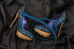 Blue shoes and belt  lying on black satin Stock Photo