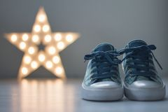 Walking shoes with star in background royalty free stock photo