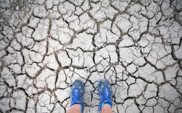 Blue shoes on a dry lake bed (selfie) Stock Image