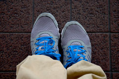Blue shoes on floor Royalty Free Stock Photos