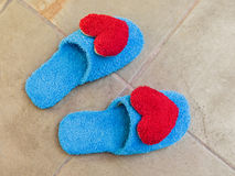 Blue shoes in house with red heart Stock Image