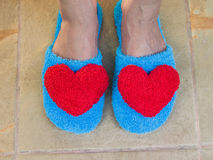 Blue shoes in house with red heart Royalty Free Stock Photo