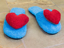 Blue shoes in house with red heart on floor Royalty Free Stock Photo