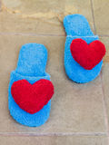 Blue shoes in house with red heart on floor Royalty Free Stock Photos