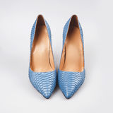 Blue shoes isolated on the white Royalty Free Stock Photo