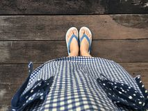Blue Shoes Isolated on Wood Floor for Top View. Woman Wearing Blue Flip Flop and Blue Scot Dress on The Wooden Floor Background. Great For Any Use Stock Photos