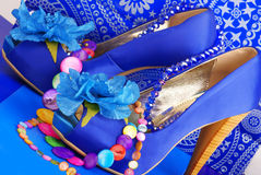 Blue shoes with necklace royalty free stock images