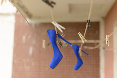 Blue Shoes on Rope Stock Photos