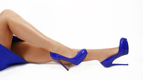 Blue shoes on sexy legs Stock Images