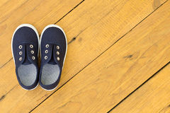 Blue shoes on wooden floor Stock Images