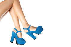 Blue shoes worn by female legs Stock Image