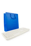 Blue Shopping Bag and Computer Keyboard Royalty Free Stock Photos
