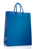 Blue shopping bag isolated Stock Images