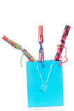 Blue shopping bag with three gifts Royalty Free Stock Photography