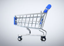 Blue shopping cart on background Stock Images