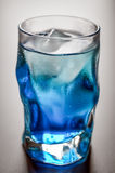 Blue shot glass with ice and condensation Stock Images