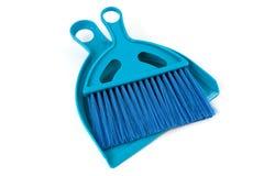 Blue shovel and brush Stock Photos
