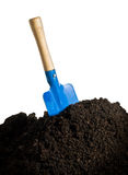 Blue shovel in the ground Stock Images